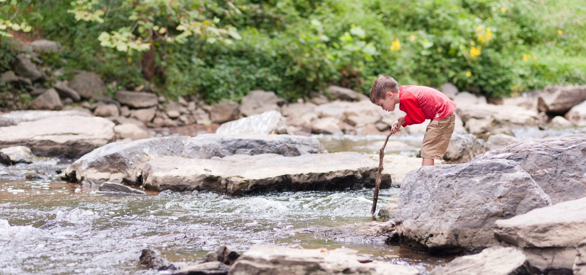 Austin Brimley playing at the river in Rock Creek Park