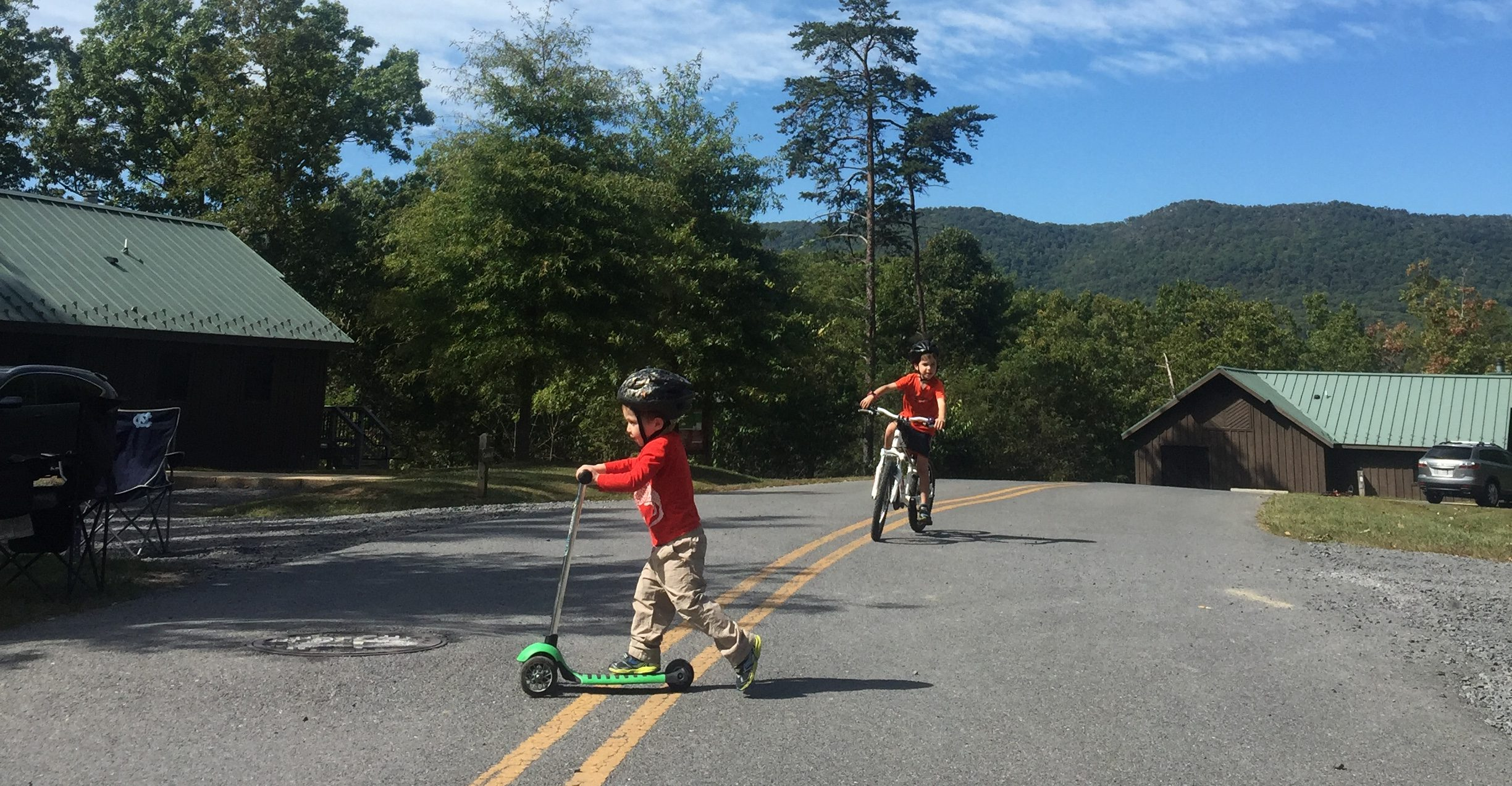 Austin and Tommy Brimley on their scooters during the last weekend before Shawn got sick
