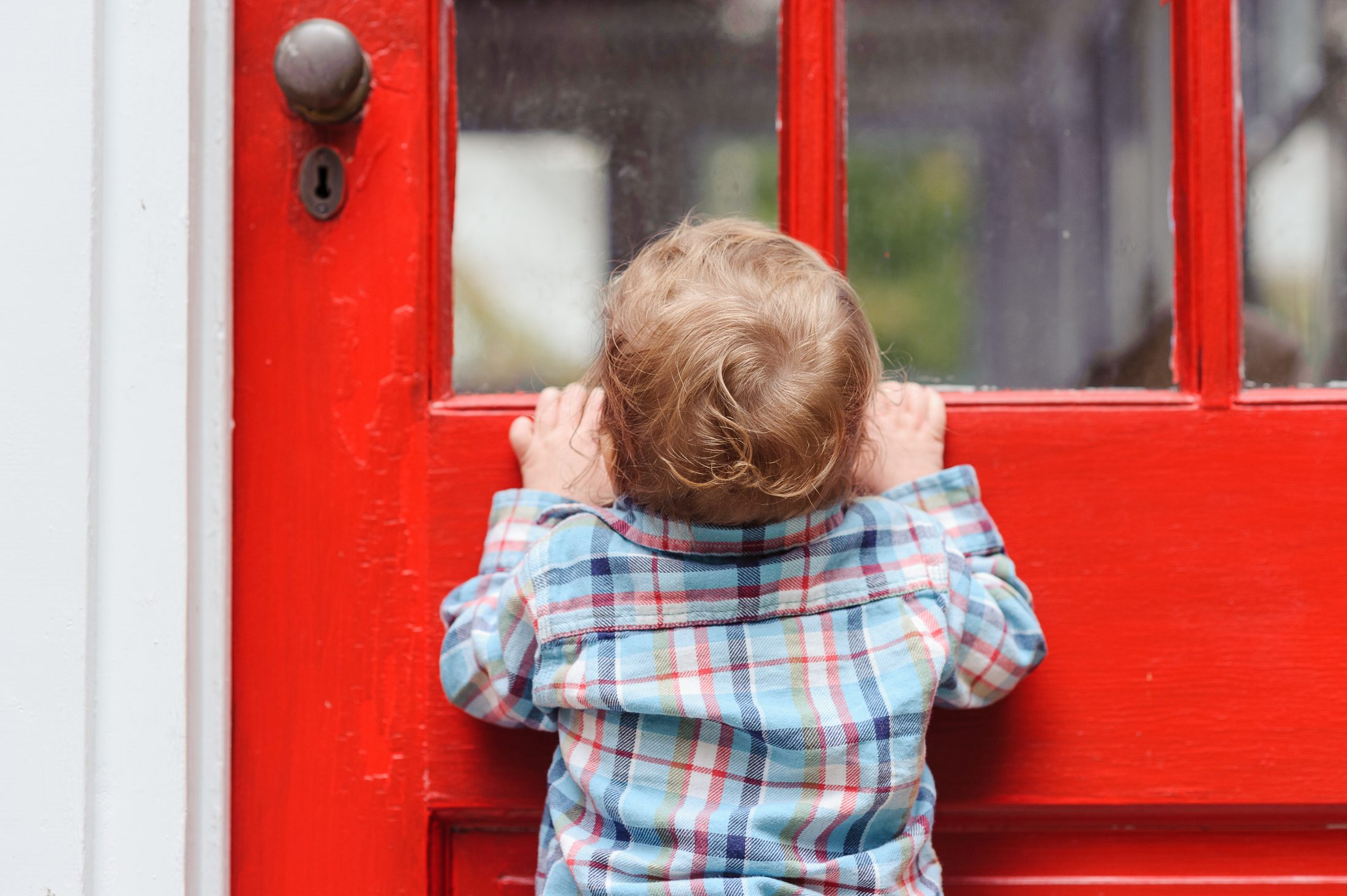 Tommy Brimley as a baby looking into his house in DC
