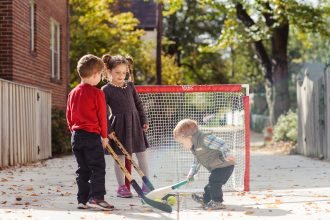 Brimley children playing hockey