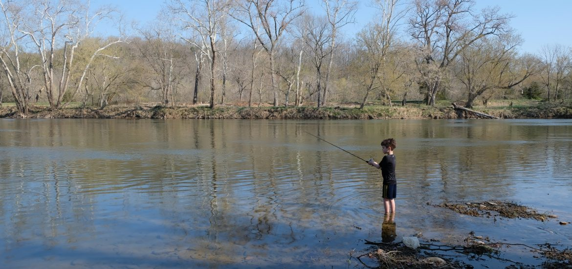 Austin Brimley fishing on camping trip in Virginia
