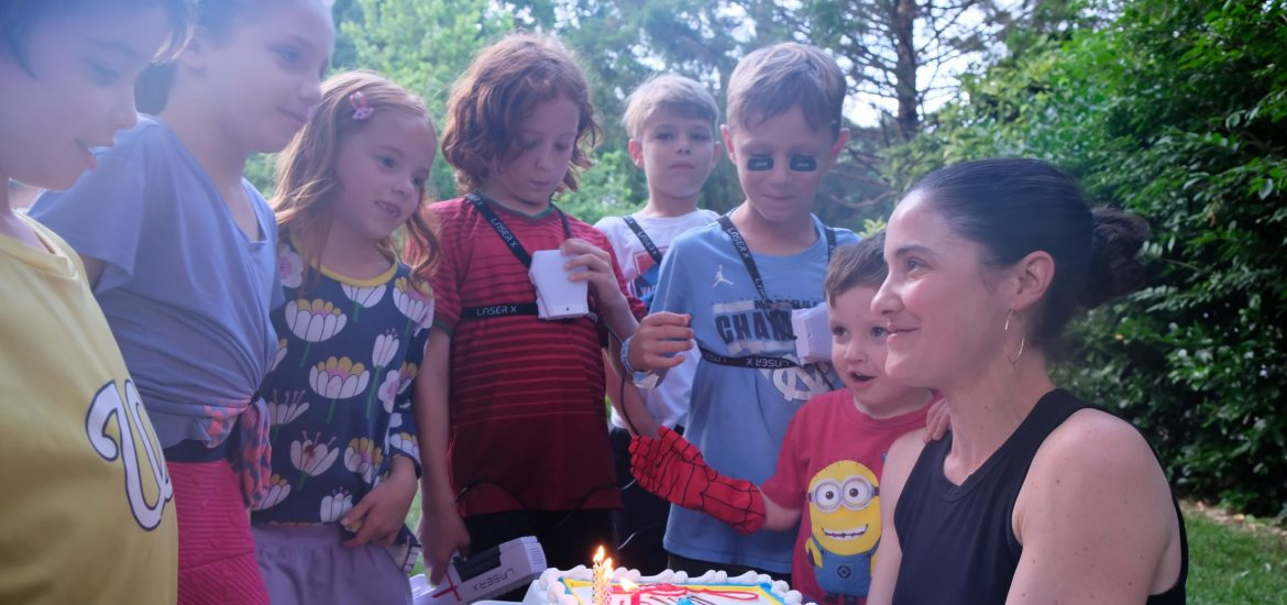 Marjorie Brimley and kids with cake for Shawn's birthday after his death
