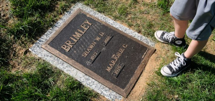 Shawn Brimley's grave with Austin's converse and Marjorie's name appearing as a widow