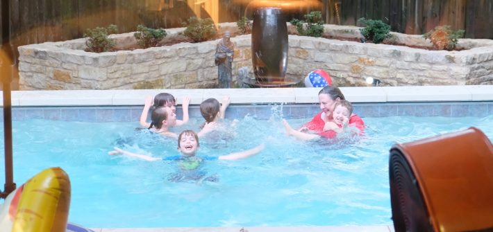 Nana and grandkids in the pool in Texas during family reunion