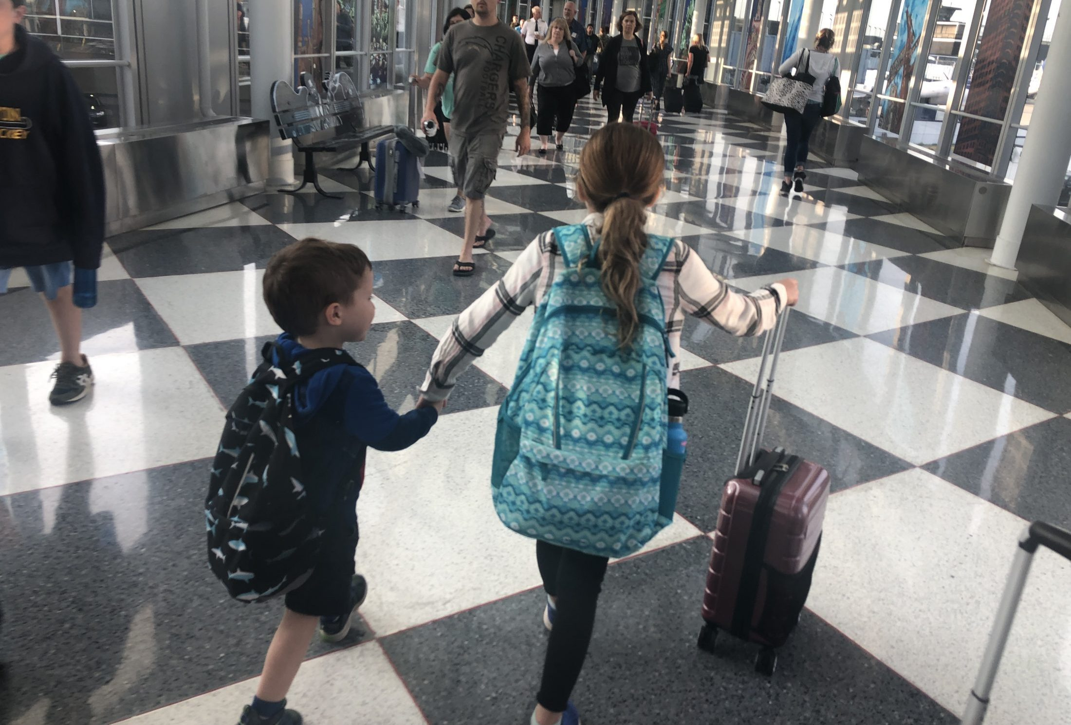 Claire Brimley holding Tommy's hand in the airport this summer