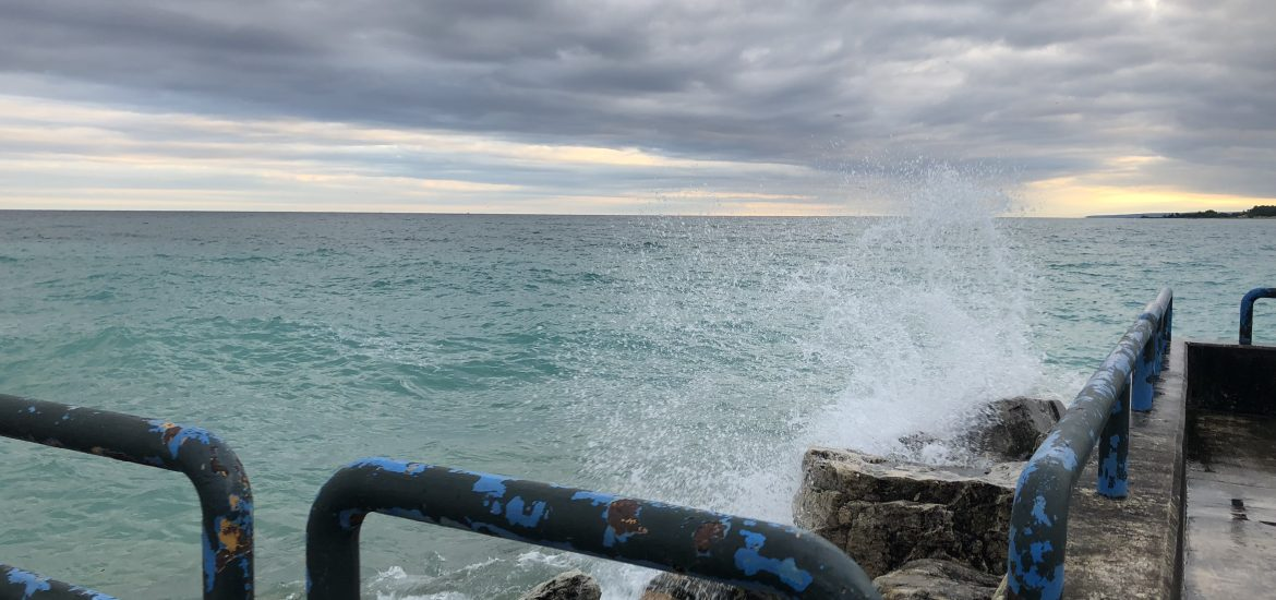 Waves crashing on the pier during Brimley family vacation