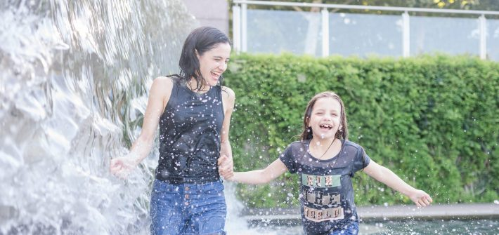 Marjorie Brimley and her daughter running through a fountain in DC after Shawn's death