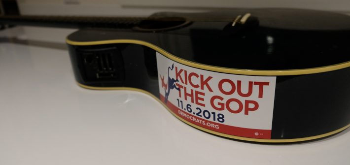 Shawn Brimley's guitar with sticker saying Kick Out the GOP