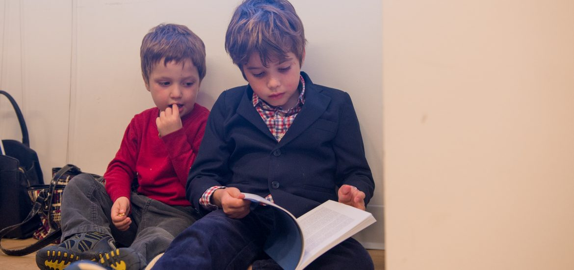 Marjorie Brimley's sons, Austin and Tommy, read a book in DC room