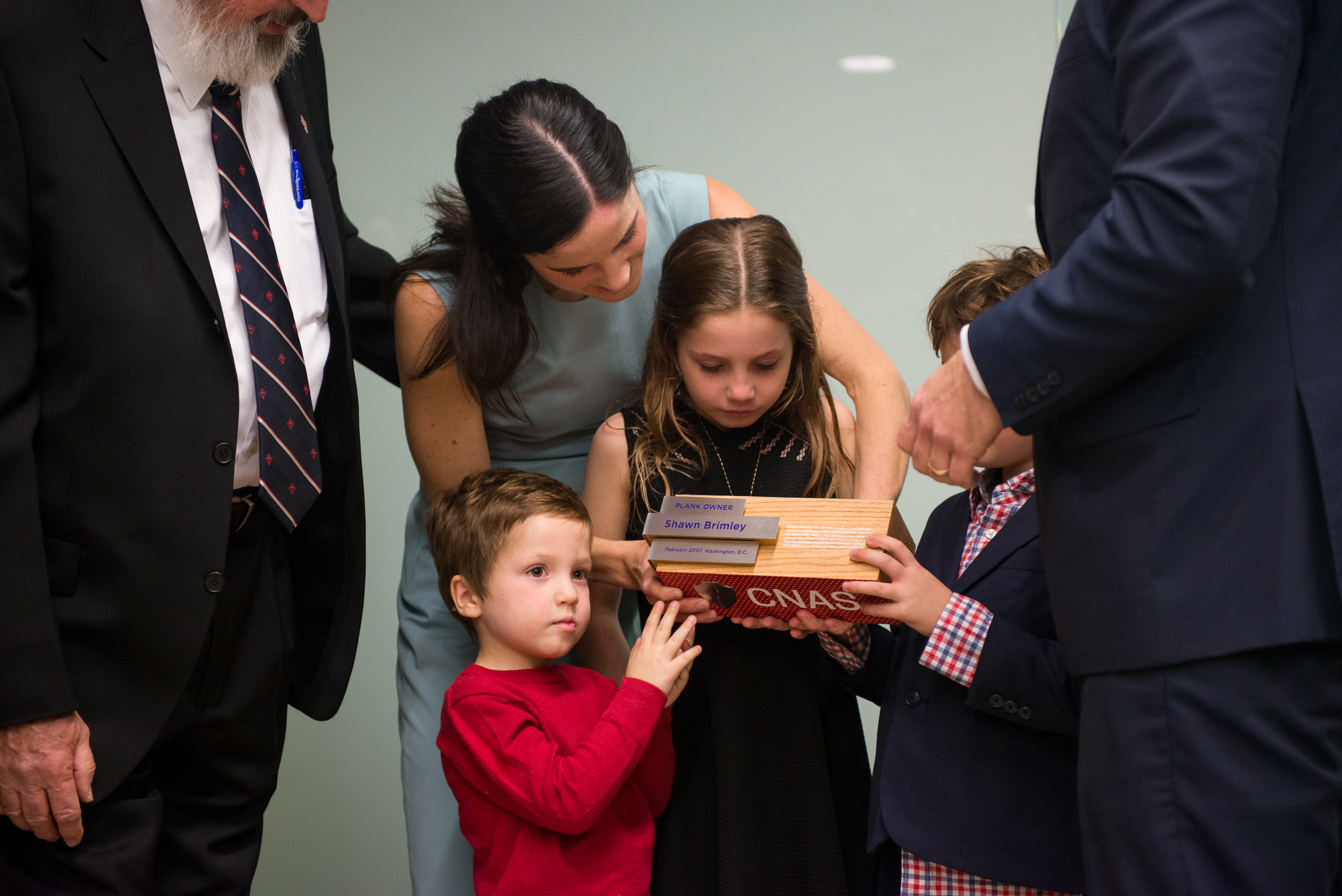 Shawn Brimley's widow Marjorie accepts plaque with her children at DC think tank
