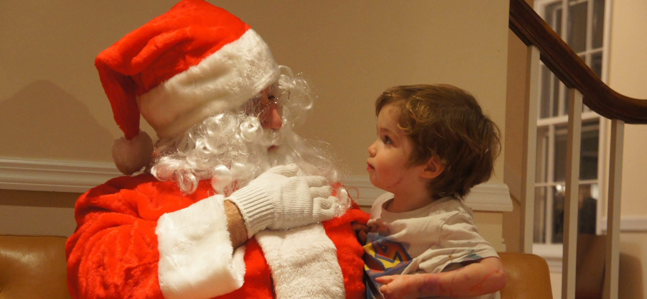 Shawn Brimley and his son Austin dressed up as Santa in the house of DC widow Marjorie Brimley