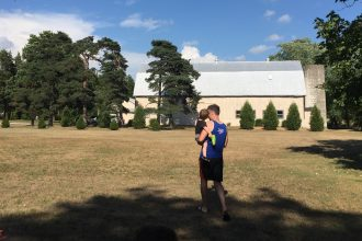 Shawn Brimley, husband of DC widow blog writer Marjorie, walks across a field with son Tommy