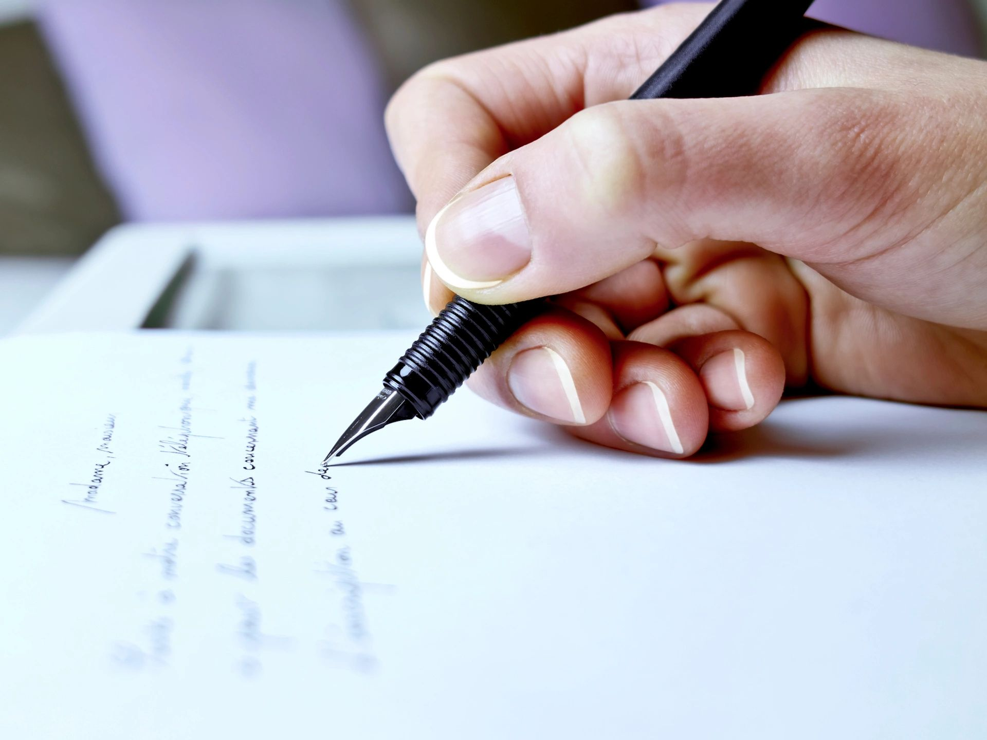 Hand writing a letter to DC widow blogger Marjorie Brimley and her daughter