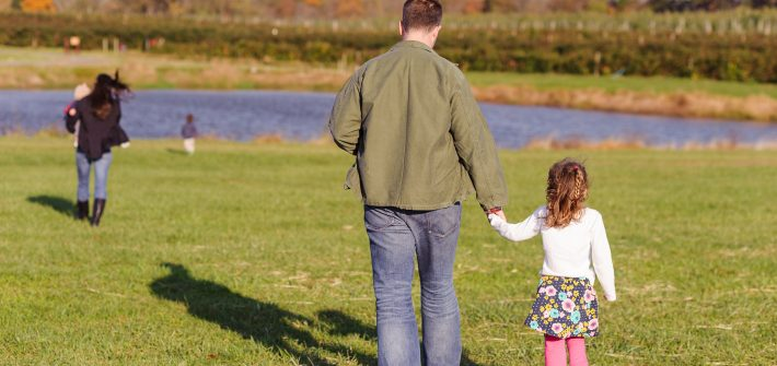 DC widow blog writer Marjorie Brimley's husband Shawn walks with daughter with wife and boys in distance