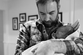 DC widow blog writer Marjorie Brimley's son, Tommy, held by his father, Shawn just after his home birth