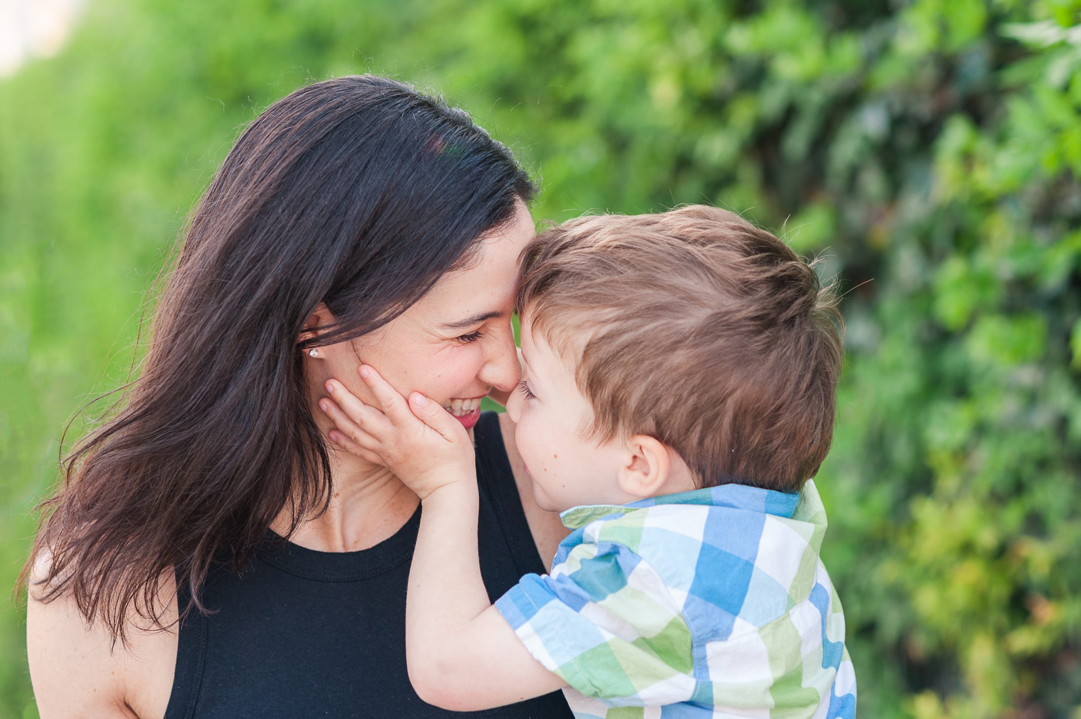 DC widow blog writer Marjorie Brimley with youngest son Tommy holding her face