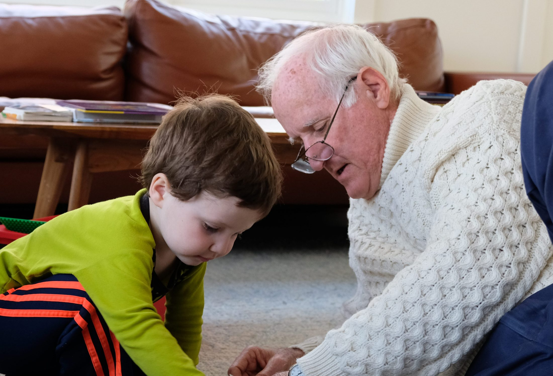 DC widow blog writer Marjorie Brimley's father, Tom, plays legos with her son Tommy