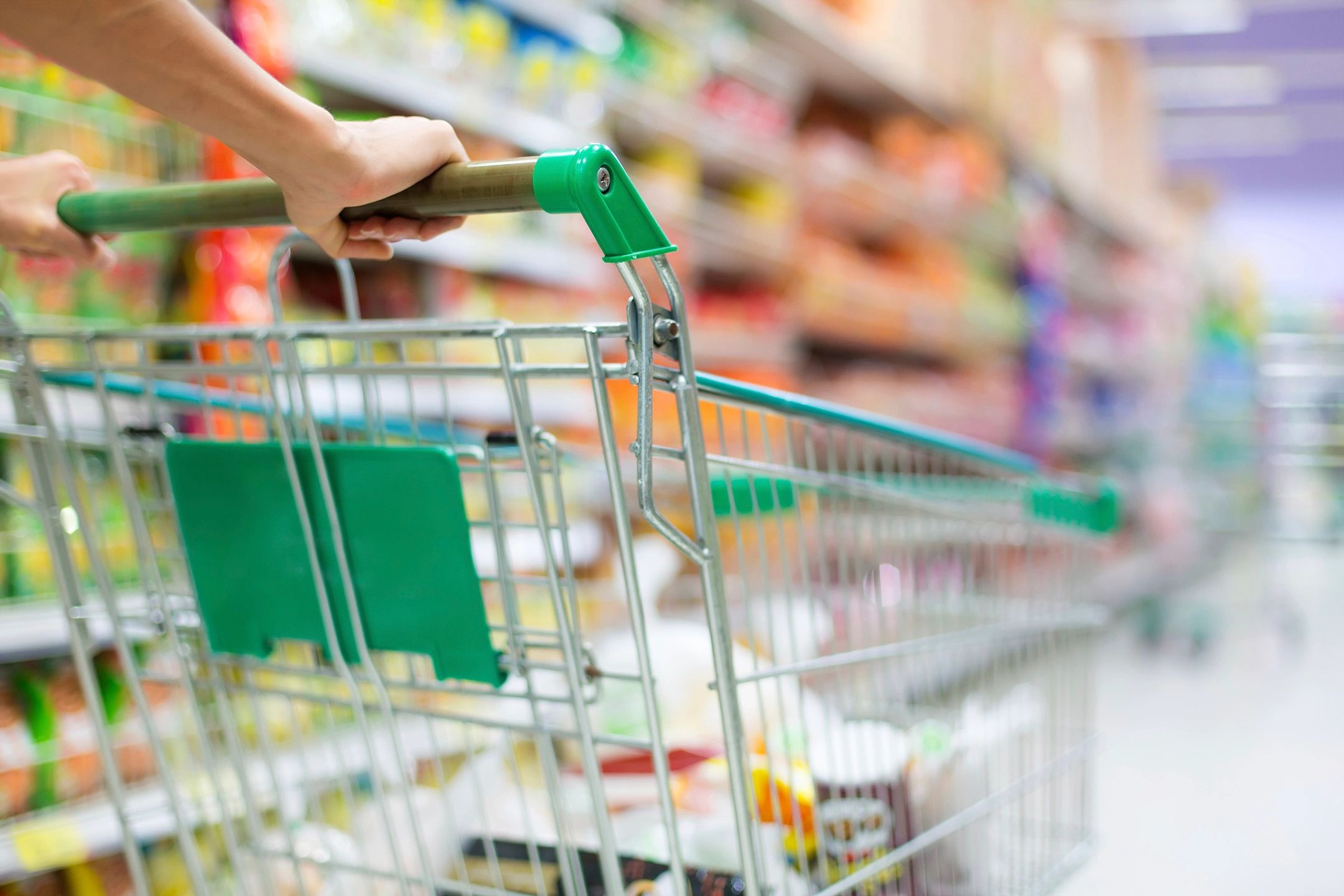 Image representing DC widow blog writer Marjorie Brimley pushing a shopping cart in a grocery store