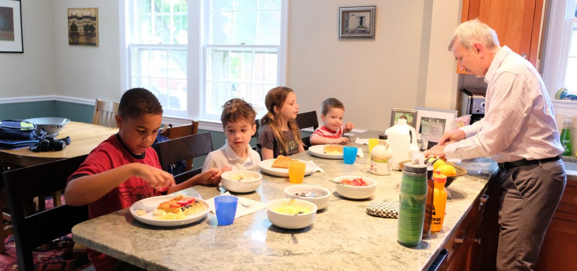 DC widow blog writer Marjorie Brimley's children eat with neighbor family at counter