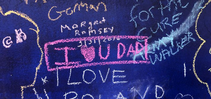 "DC widow blog writer Marjorie Brimley's daughter Claire writes ""I love you Dad"" on memory board"