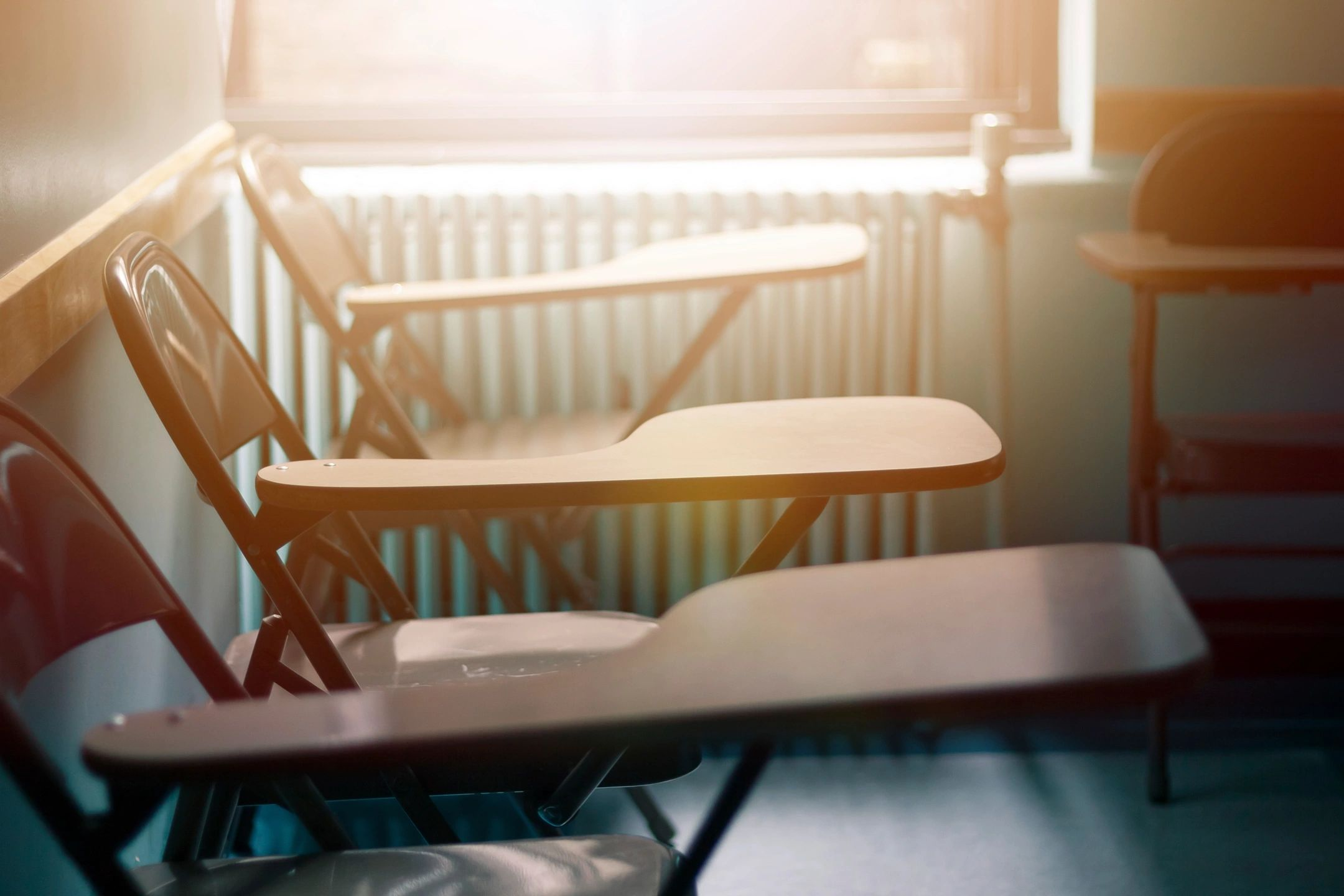 Image of 3 desks in classroom like that of DC widow blog writer Marjorie Brimley