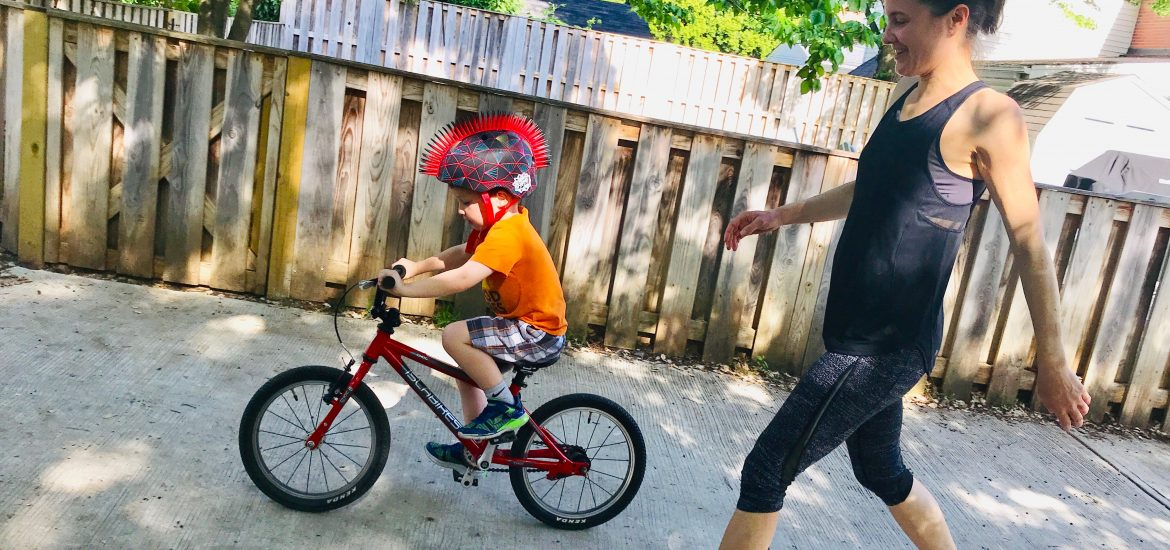 DC widow blog writer Marjorie Brimley teaching her son Tommy to ride a bike in Washington DC