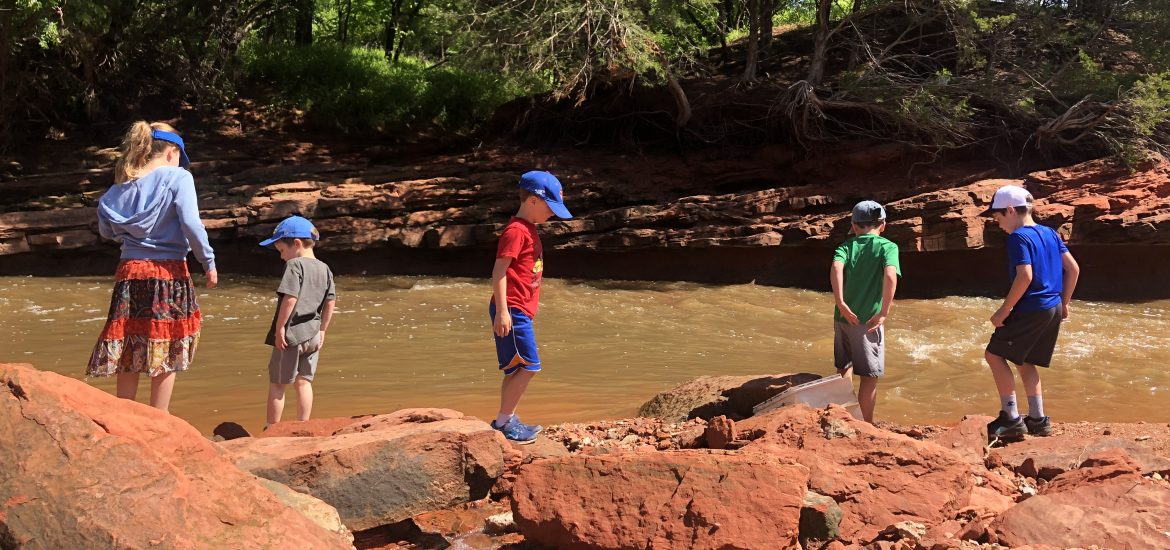 DC widow blog writer Marjorie Brimley's children and their cousins play along a river