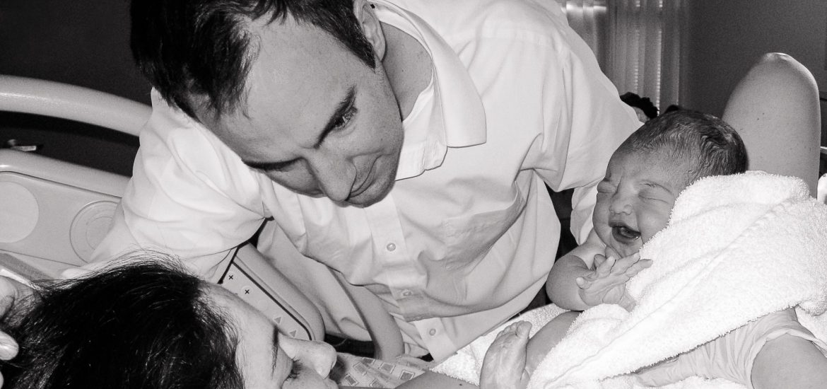 DC widow blog writer Marjorie Brimley with her husband and child on the day she became a mom