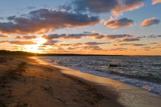 Sunset on beach similar to that experienced in post by DC widow blog writer Marjorie Brimley