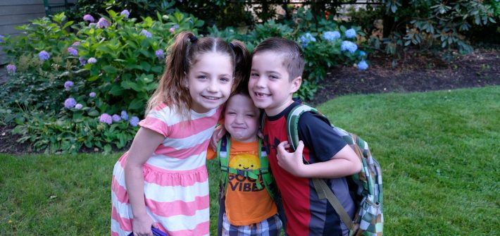 Children of DC widow blog writer Marjorie Brimley smile in yard on last day of school