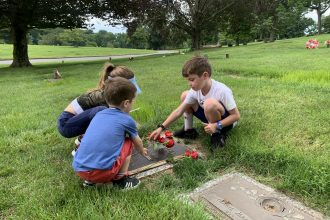 Children of DC widow blog writer Marjorie Brimley put roses on their father's grave on Father's Day