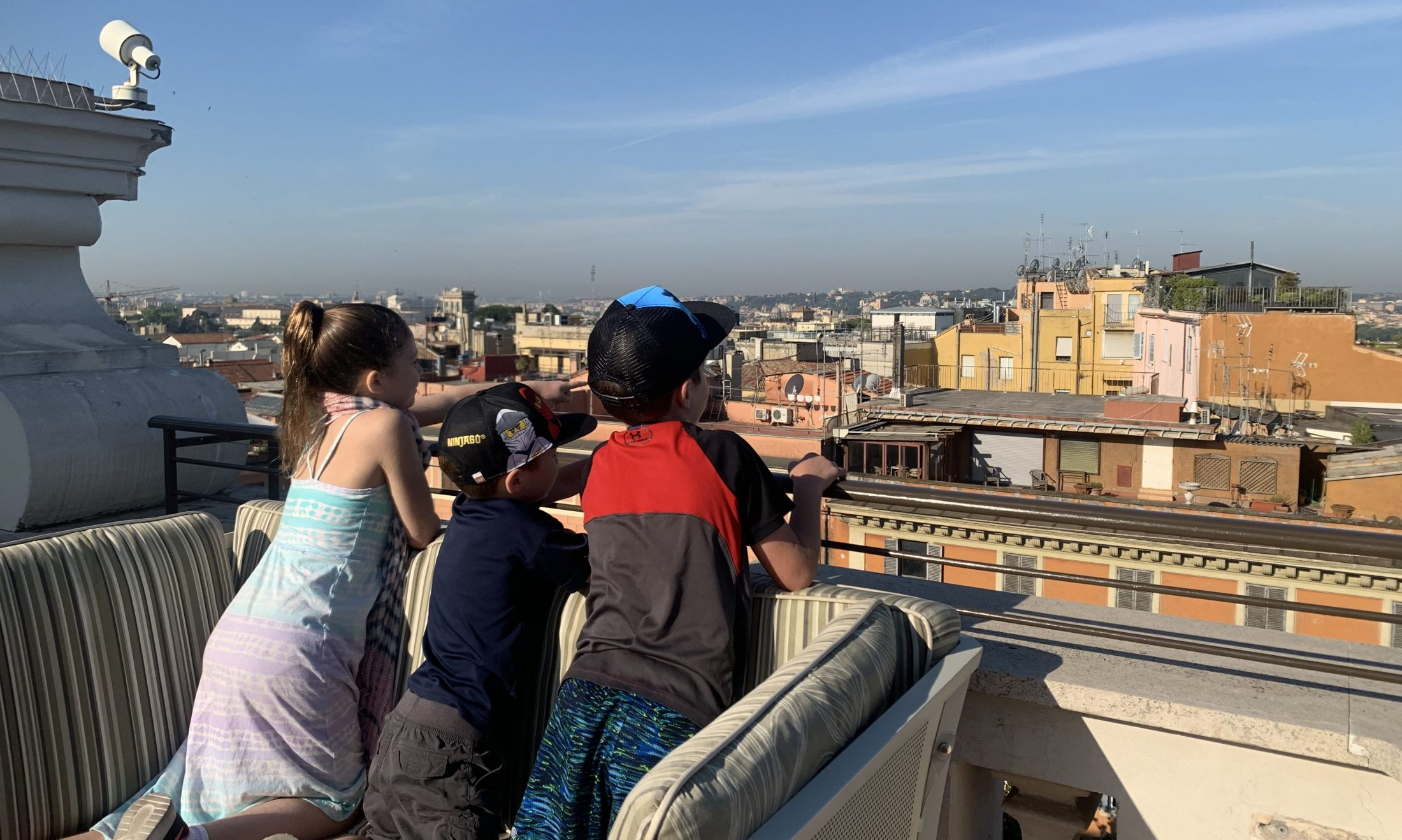Children of DC widow blog writer Marjorie Brimley look out over Rome Italy