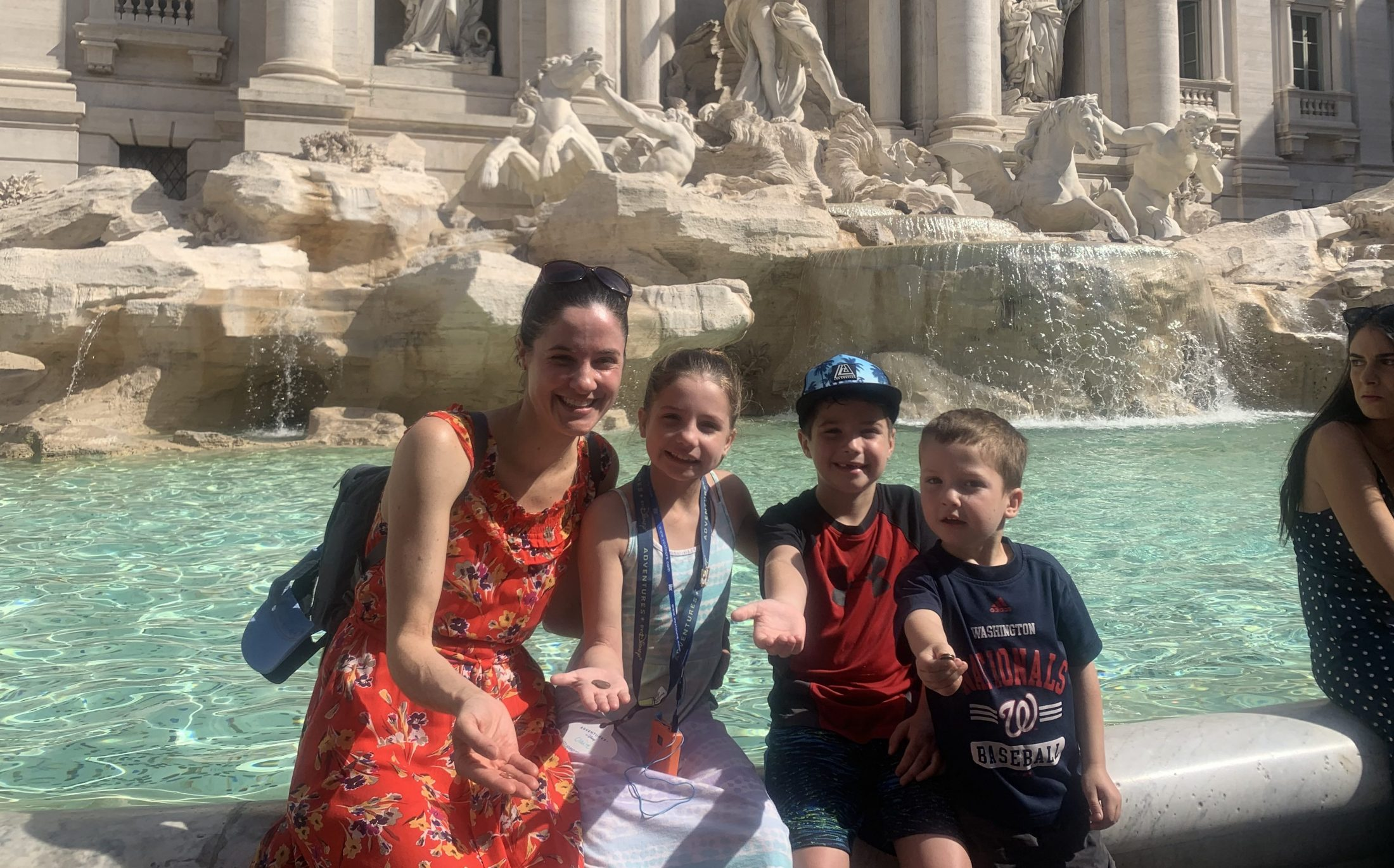 DC widow blog writer Marjorie Brimley and her three children in front of the Trevi fountain in Rome