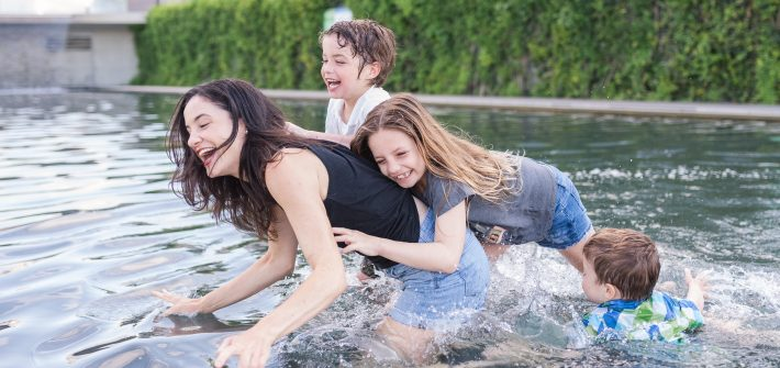 DC widow blog writer Marjorie Brimley with her three children tackling her in the water