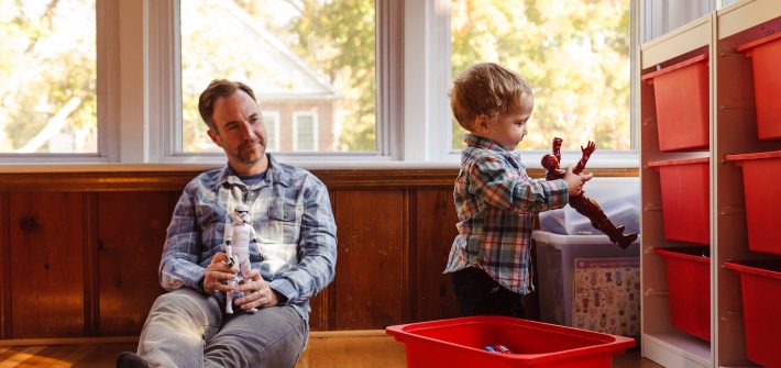 DC widow blog writer Marjorie Brimley's husband Shawn plays with his youngest son in playroom