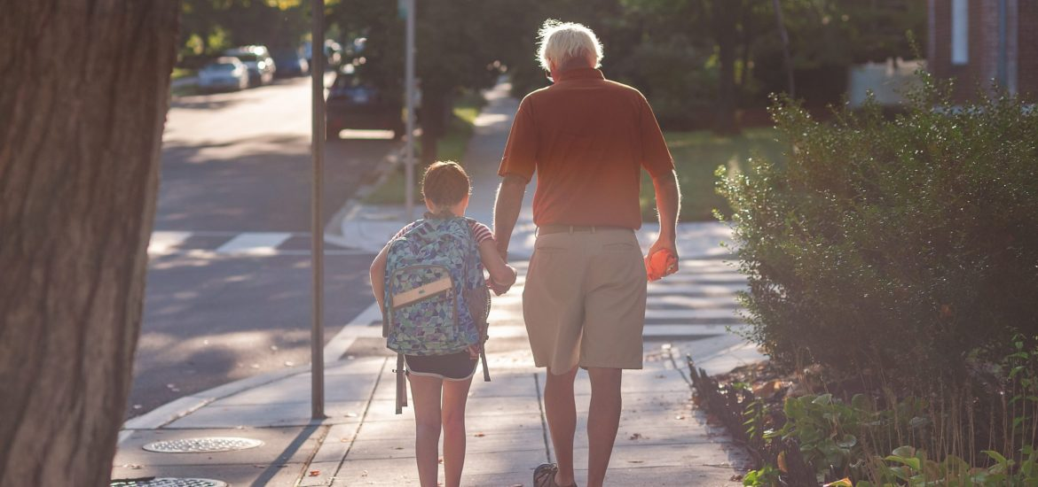 Father and child of DC widow blog writer Marjorie Brimley walk to school