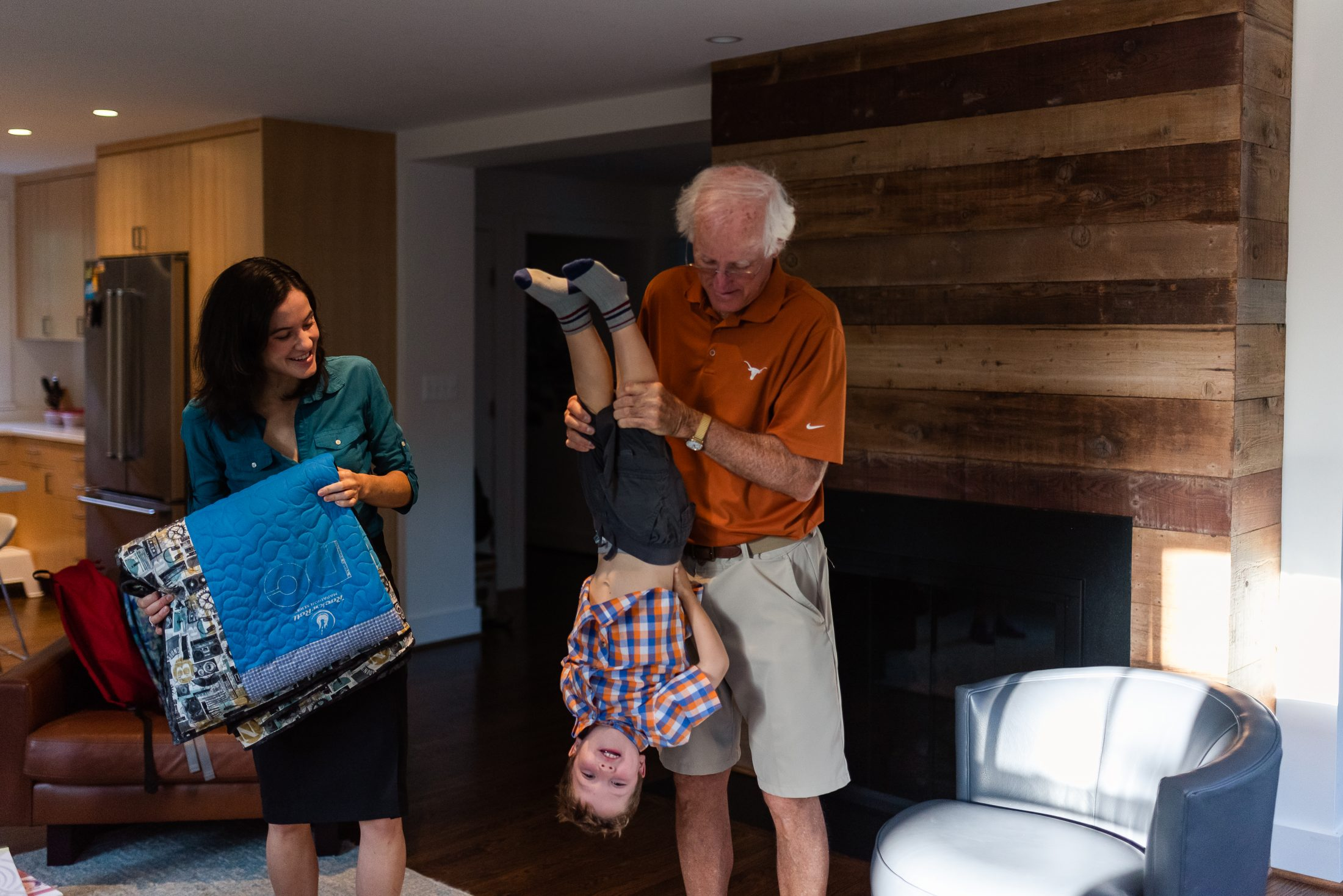 Father of DC Widow blog writer Marjorie Brimley, Tom Clark, swings his grandson Tommy around room