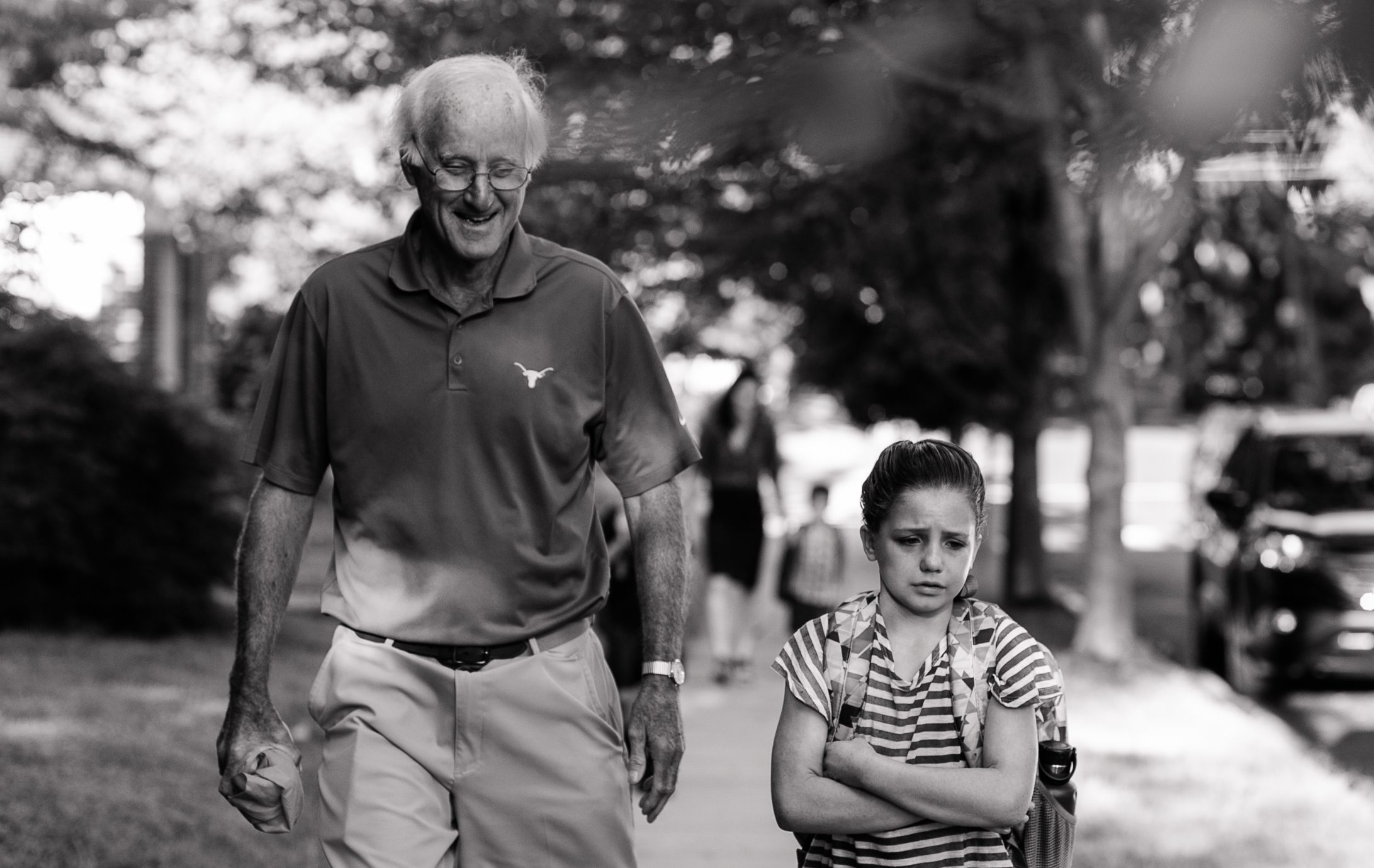 Daughter of DC widow blog writer Marjorie Brimley crosses arms and frowns while Grandfather smiles at her