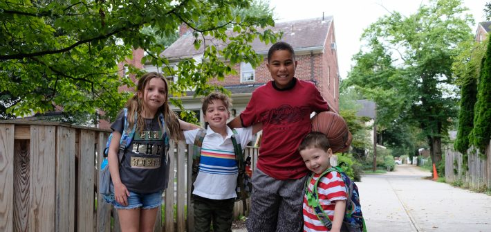 Grant and children of DC widow blog writer Marjorie Brimley put arms around each other in alley