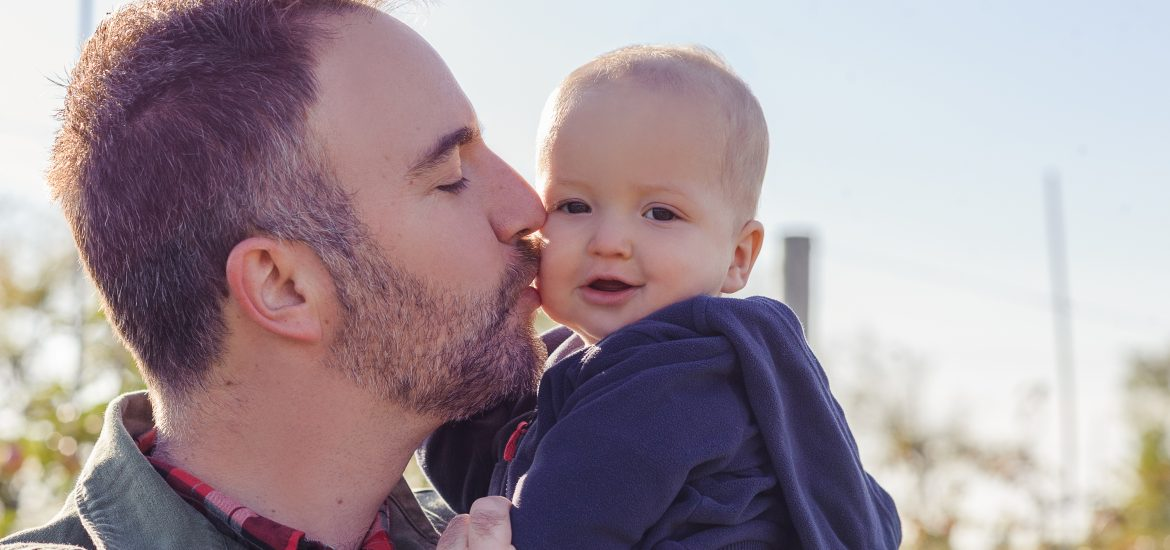 Husband of DC widow blog writer Marjorie Brimley kisses their baby on the cheek