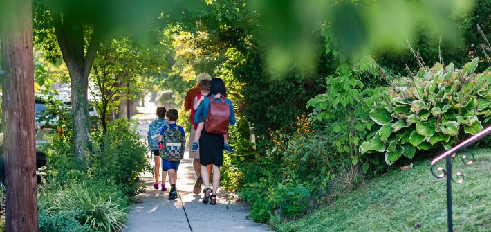 DC widow blog writer Marjorie Brimley walks with children and father to school
