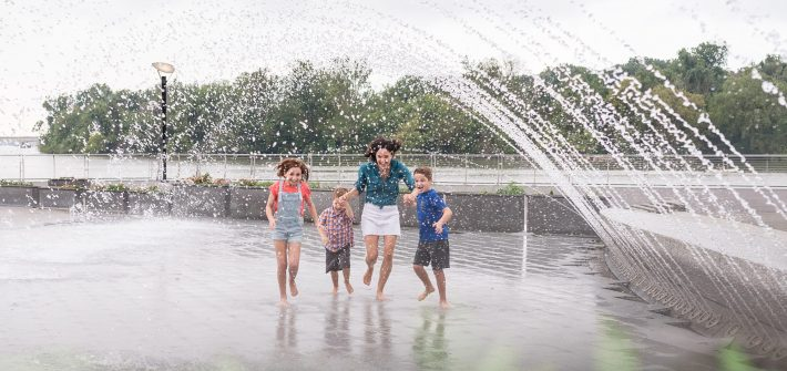 DC widow blog writer Marjorie Brimley runs through fountain with children