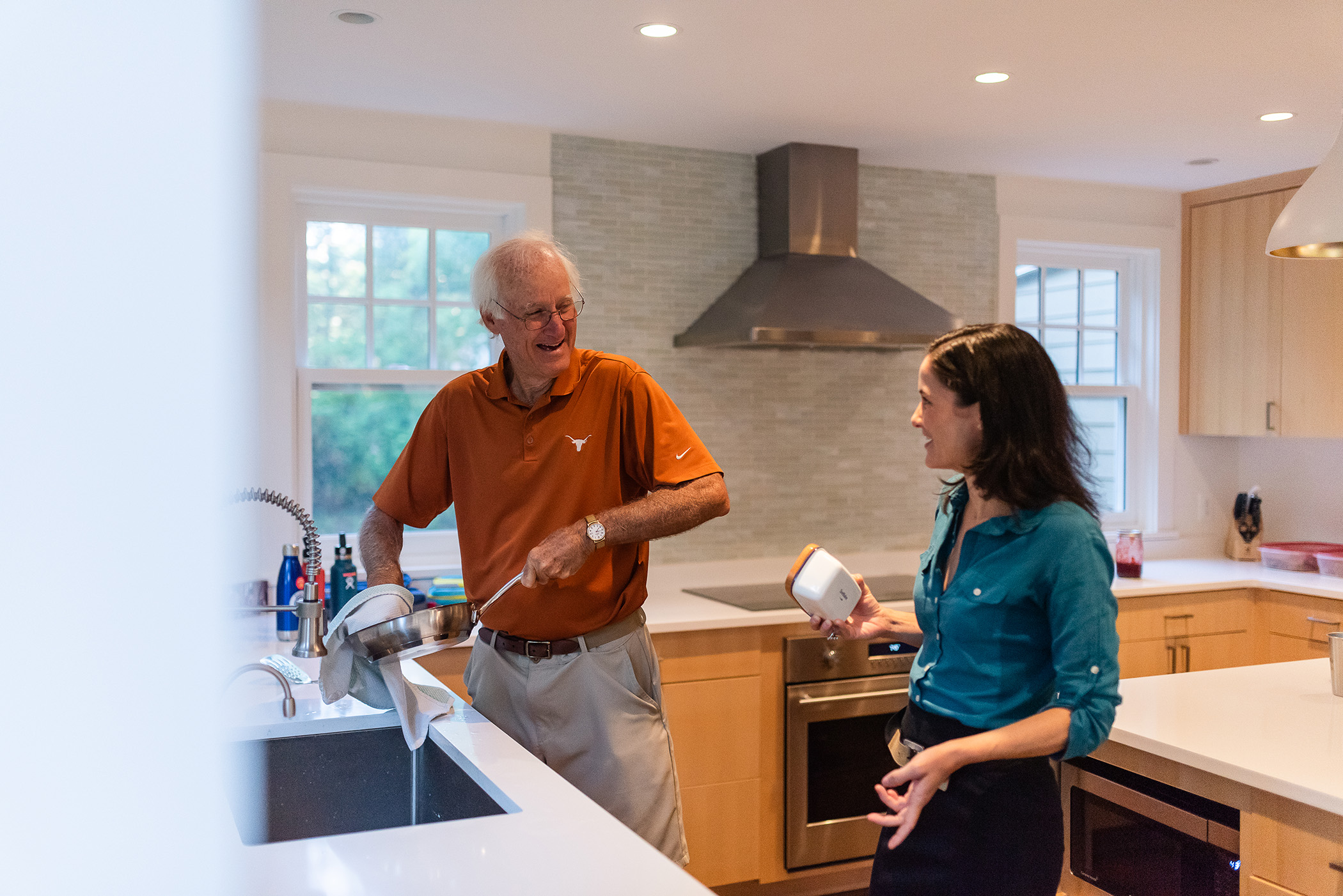 DC widow blog writer Marjorie Brimley in the kitchen with her father washing dishes
