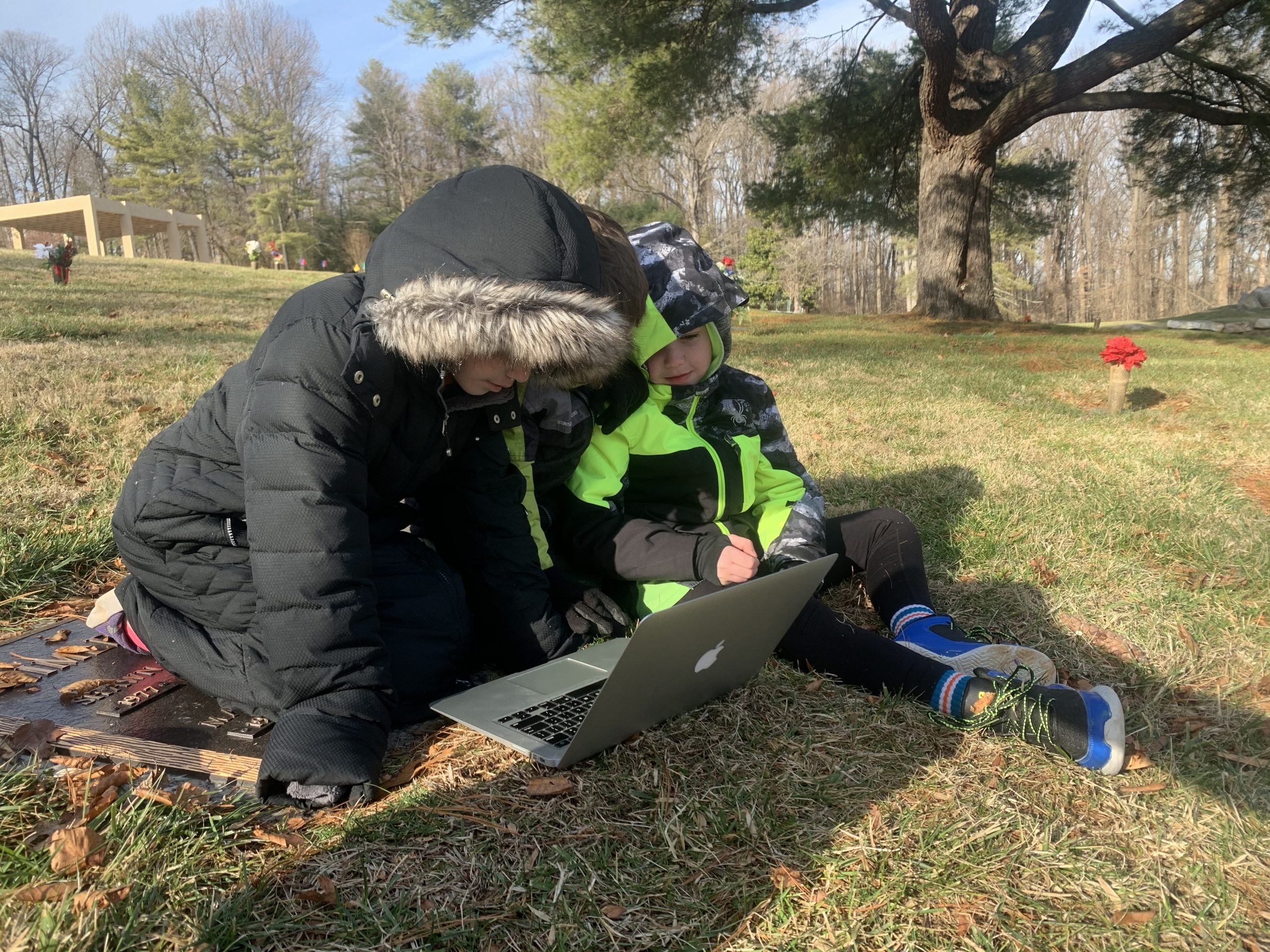 Children of DC widow blog writer Marjorie Brimley at the grave of their father