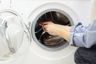 Arms in washing machine like that of DC widow blog writer Marjorie Brimley