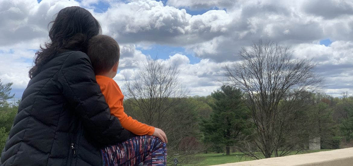 DC widow blog writer Marjorie Brimley with son Tommy looks away from camera