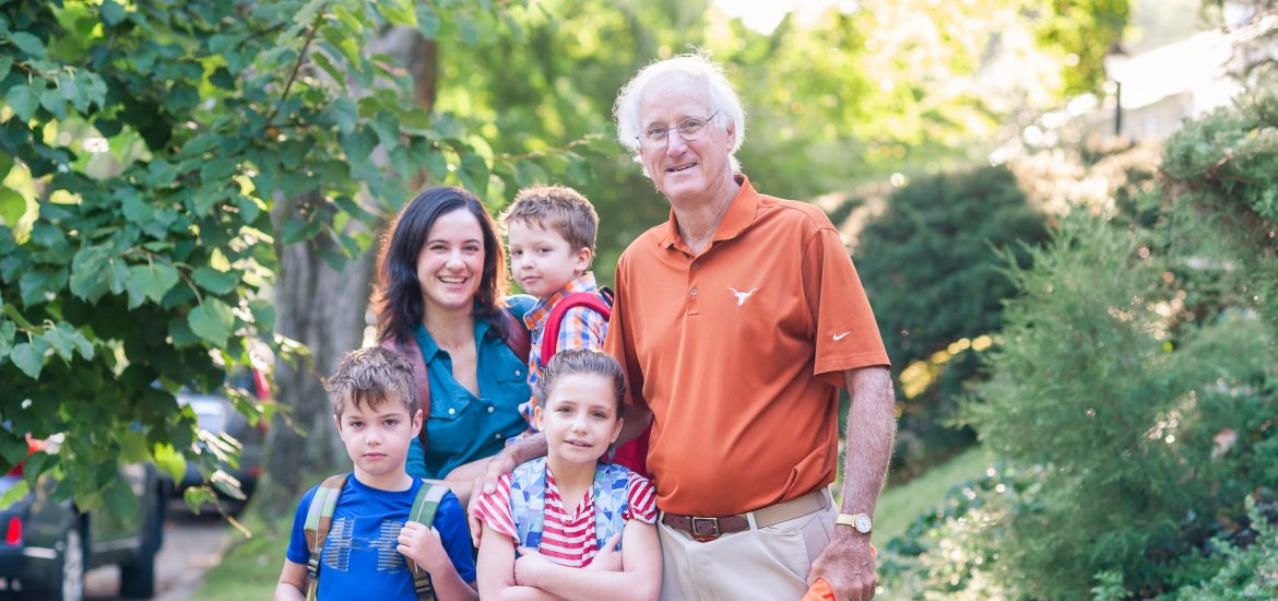 DC widow blog writer stands with her father and children