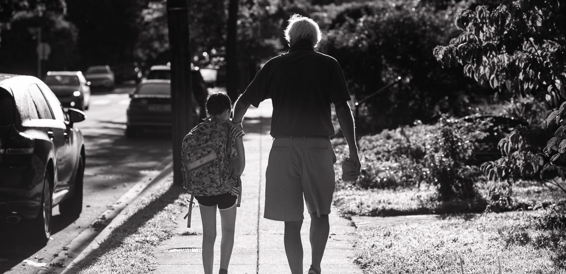 Father of DC widow blog writer Marjorie Brimley walks with granddaughter in black and white photo