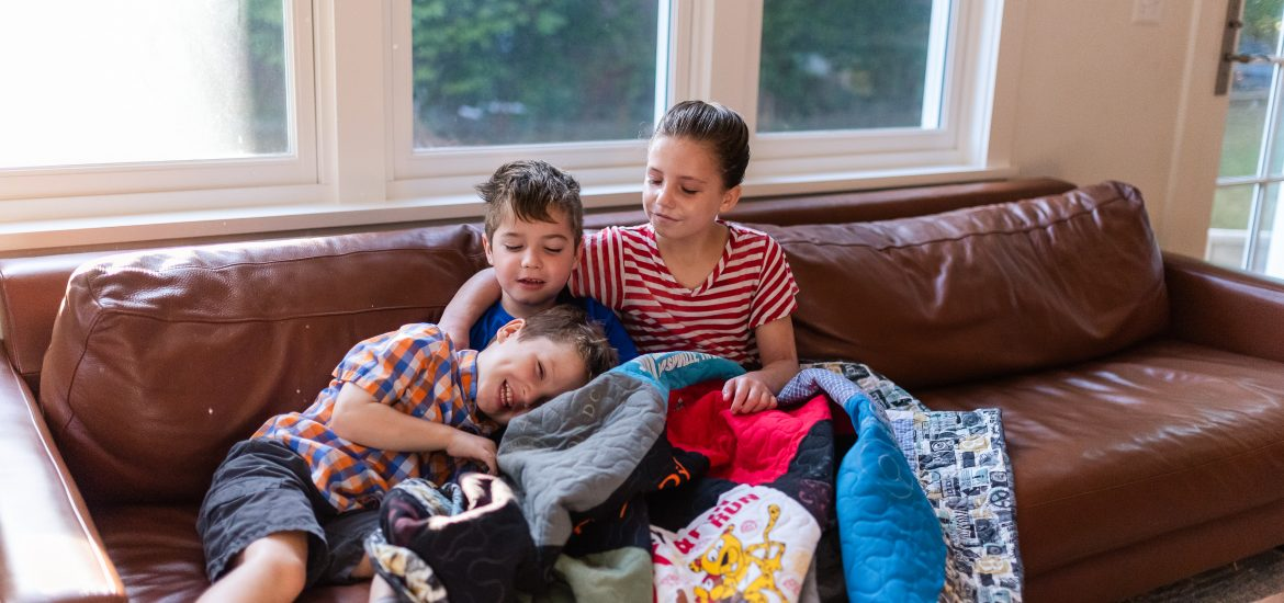 Children of DC widow blog writer Marjorie Brimley lay on couch together