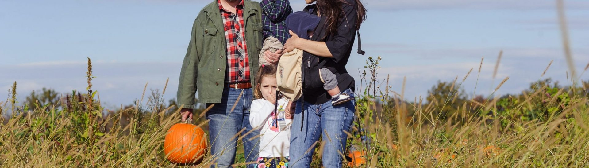 DC widow blog writer Marjorie Brimley with family in field
